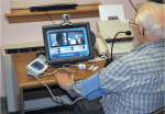 A patient uses telehealth equipment to communicate with his nurse. Photo courtesy of Janet Grady.