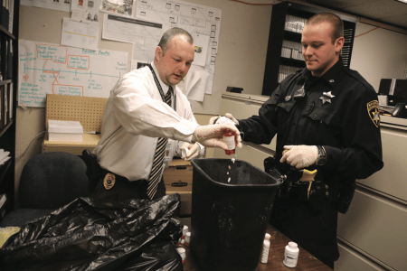 More than 800 lbs. of drugs have been collected in Lycoming County, PA, since drug collection boxes were placed in law enforcement agencies over a year ago, allowing residents to safely dispose of unwanted drugs. Here the drugs are separated from their containers before incineration. Photo courtesy of Karen Vibert-Kennedy / Williamsport Sun-Gazette.