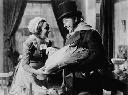 Bob Cratchit gives Mrs. Cratchit a Christmas goose