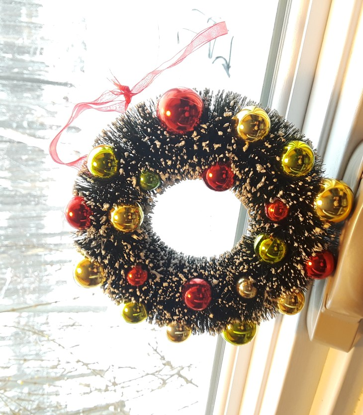 mini wreath with red and gold ornament embellishment