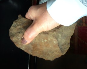 stone scraper fitting well into the palm of hand