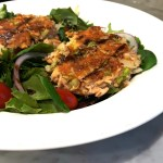 Salmon cakes served with baby greens and a simple vinaigrette