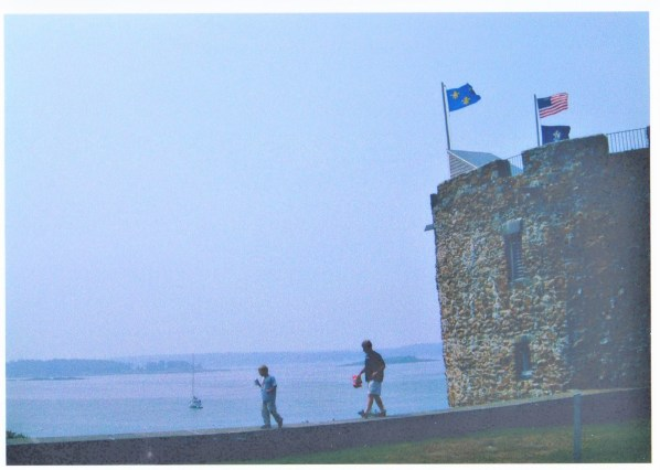Father and son walk along the wall outside of the reconstructed Fort William Henry