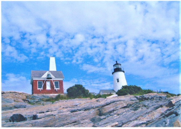 A lighthouse on a small, rocky island off the coast of Maine