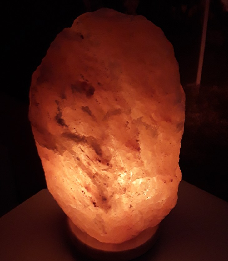 Himalayan salt lamp emits a rosy glow