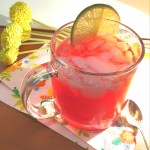 Mug of pomegranate fizz with lime slice
