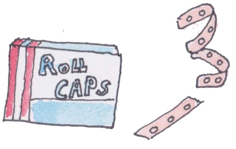 Box of caps and strip of caps