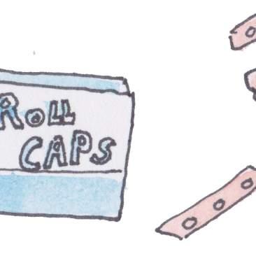 Box of caps and strip of caps