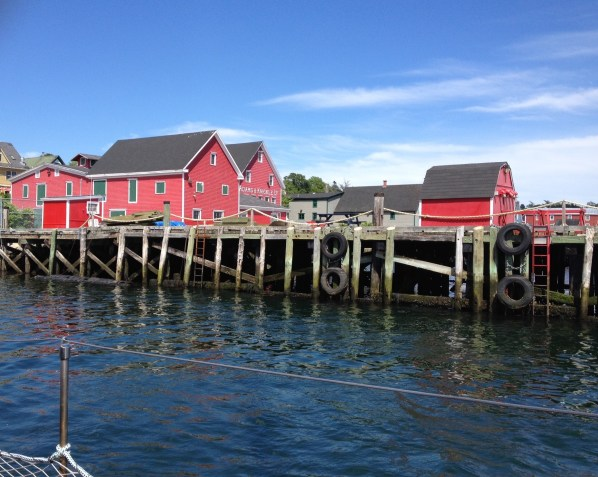 Bright red warehouses built on the wharf