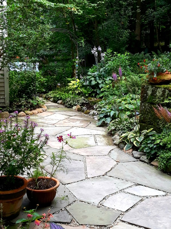 a bluestone path leads through the garden