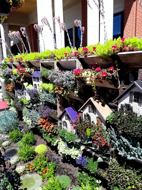 mini houses and plants form a village display