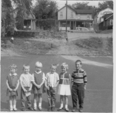 Six kindergarten students line up for a photo.