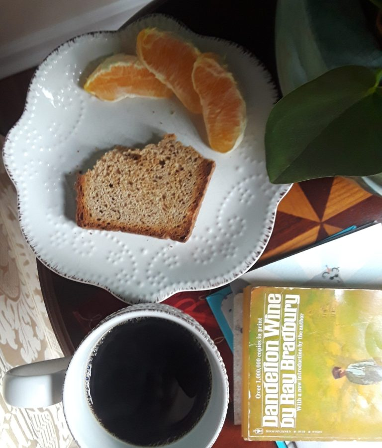 black coffee, dry toast and orange slices are a typical breakfast