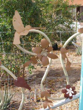 Recycled metal and found objects. Created April 2014 by Kathy Whitman and members of the community.