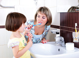 Mother Teaching Child Cleanliness