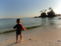 Chasing little E because he keeps trying to go back to the water.