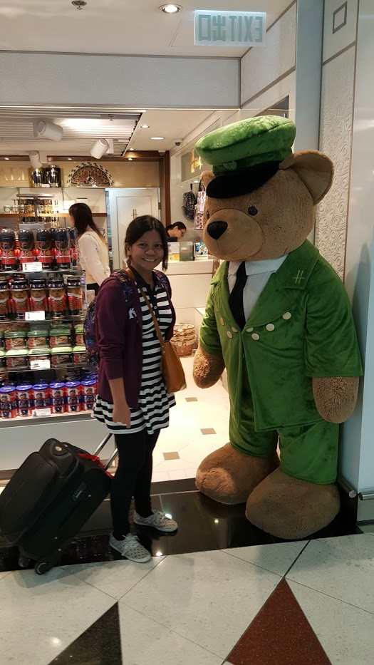 Posing with the Harrds Bear at the Harrods Store