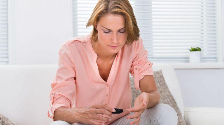woman monitoring diabetes skin prick test