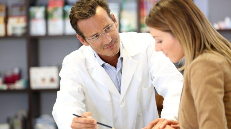 pharmacist talking with customer