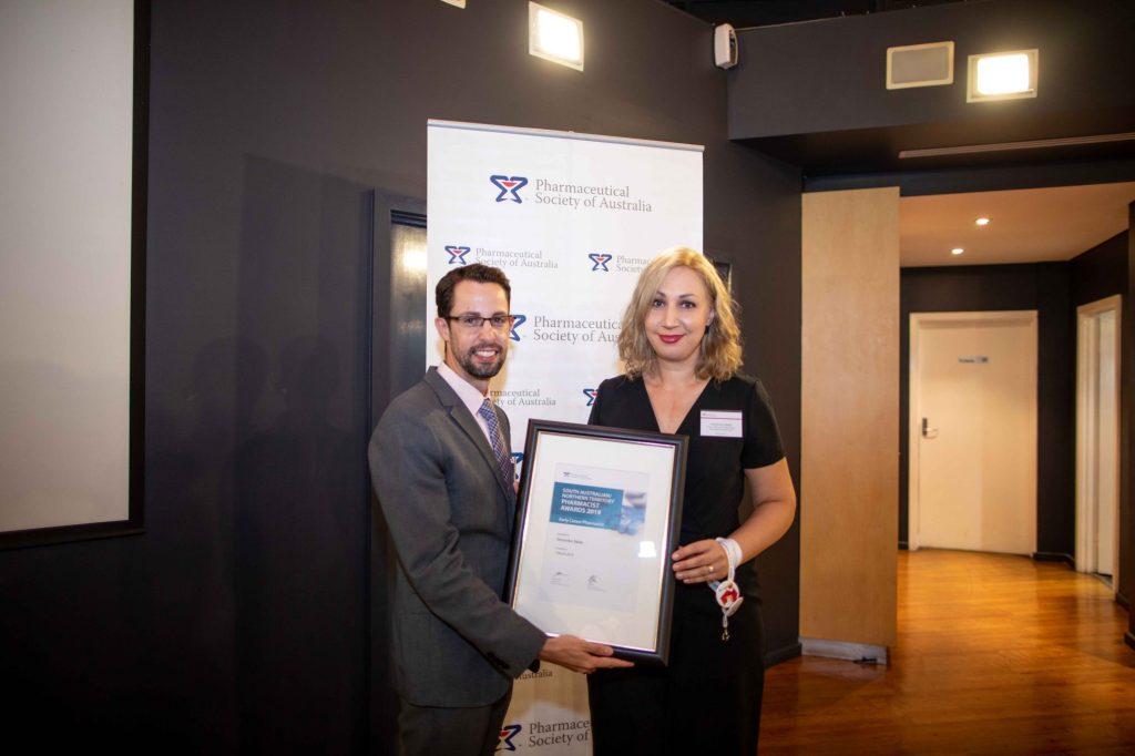 Dr Chris Freeman presents Veronika Seda with the SA/NT Early Career Pharmacist Development Award