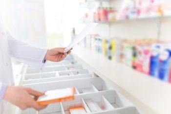 pharmacist holding script, medicine