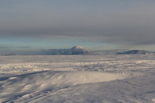 A good view of Mt. Discovery from the Sea Ice. Most of the features that you can see on the ice are from drift (strong winds blowing ice and snow around over the Sea Ice). © A. Padilla
