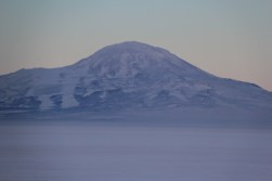 View of Mt. Discovery across the sound from McMurdo station. Note that the thick band at the base of the mountain (from the picture above) is absent. © A. Padilla