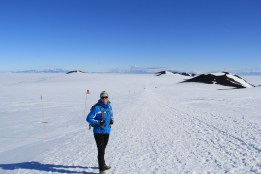 Bev, on the Castle Rock Trail. The view is South, towards McMurdo, with Mt. Discovery at center in the distance. © A. Padilla