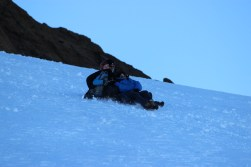 Sliding down the base of Castle Rock: much faster than hiking in the snow! © C. Kelleher