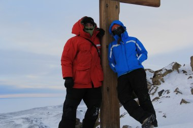 Bev and Abe hanging out at the top of Ob Hill, with the Memorial Cross to the lost Polar Party of 1912. © A. Padilla