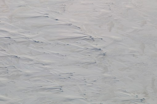 Wind-blown snow features on the sea ice surface, McMurdo Sound, Antarctica. © A. Padilla