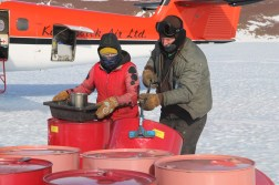 Fuel Operators preparing barrels for sampling at Odell Glacier, Antarctica. © A. Padilla