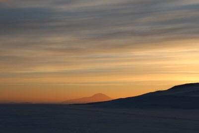 A beautifully illuminated Mt. Discovery marks the horizon. © A. Padilla