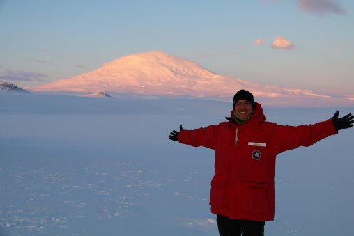 Abe enjoys a beautiful view of Mt. Erebus, the southermost active volcano in the world. © A. Padilla