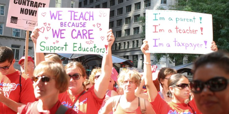 CTU members rally with signs: We teache because we care and I'm a parent, I'm a teacher, I'm at taxpayer