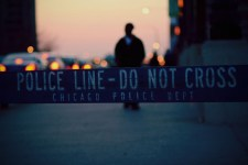 "A Chicago police barricade reading ""Police Line - Do Not Cross"""