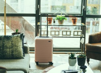 pink suitcase in chic room of airbnb rental