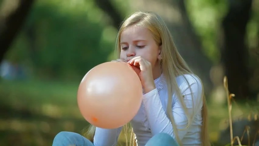 Child Blowing up a Balloon Stock Footage Video (100% Royalty-free) 3091741    Shutterstock