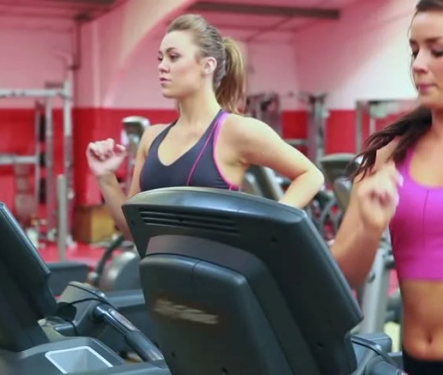 Two Women Running On Treadmills Stock Footage Video 100 Royalty Free 2905360 Shutterstock