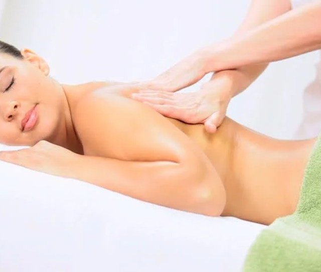 Brunette Caucasian Female Enjoying Massage Therapy At A Luxury Health Spa