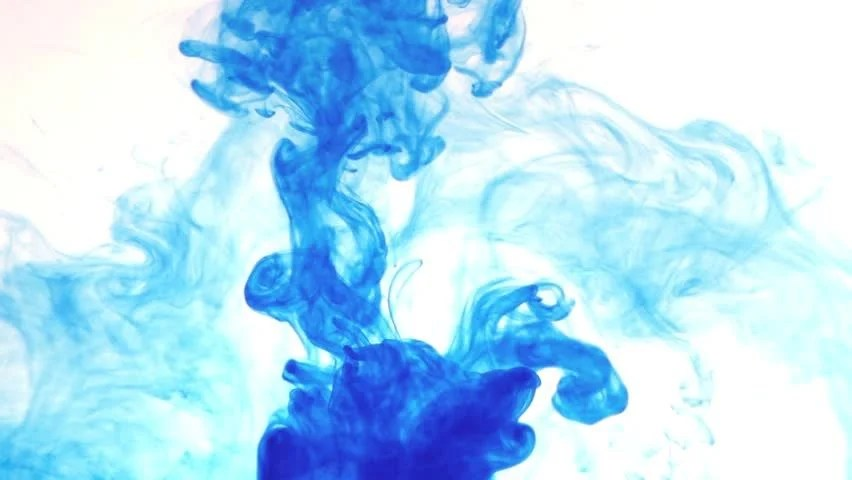 Color Ink Flowing In Water On White Background Stock