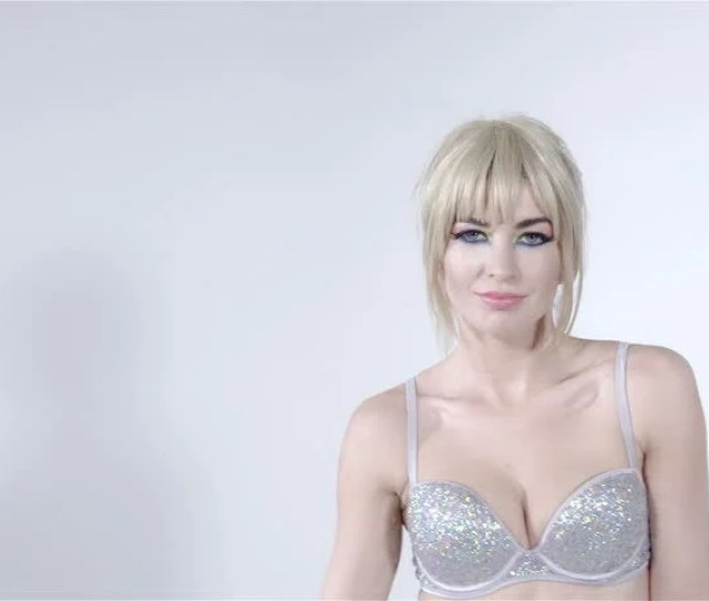 Cheerful Blonde Girl With Fringe Wearing Diamond Bra Dancing In Studio Pretty Young Girl Wearing Shining Bra Making Sexy Moves