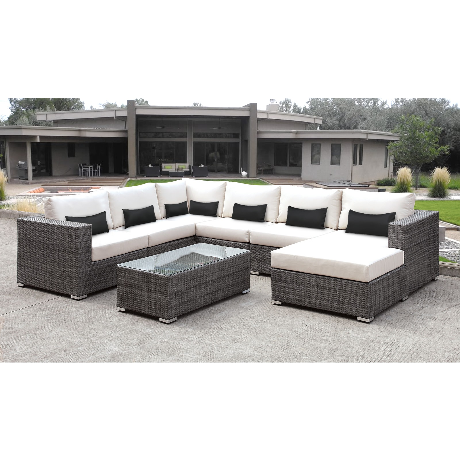 solis lusso 7 piece outdoor sectional grey wicker rattan patio with white cushions and black toss pillows