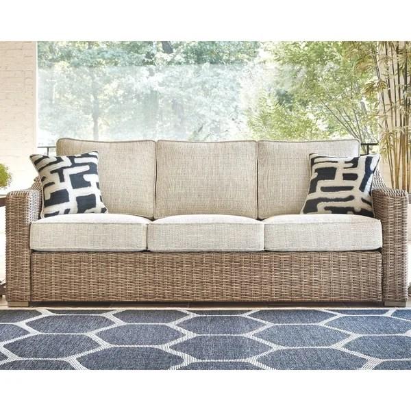 Shop Signature Design by Ashley Beachcroft Beige Outdoor ... on Beachcroft Beige Outdoor Living Room Set  id=85727