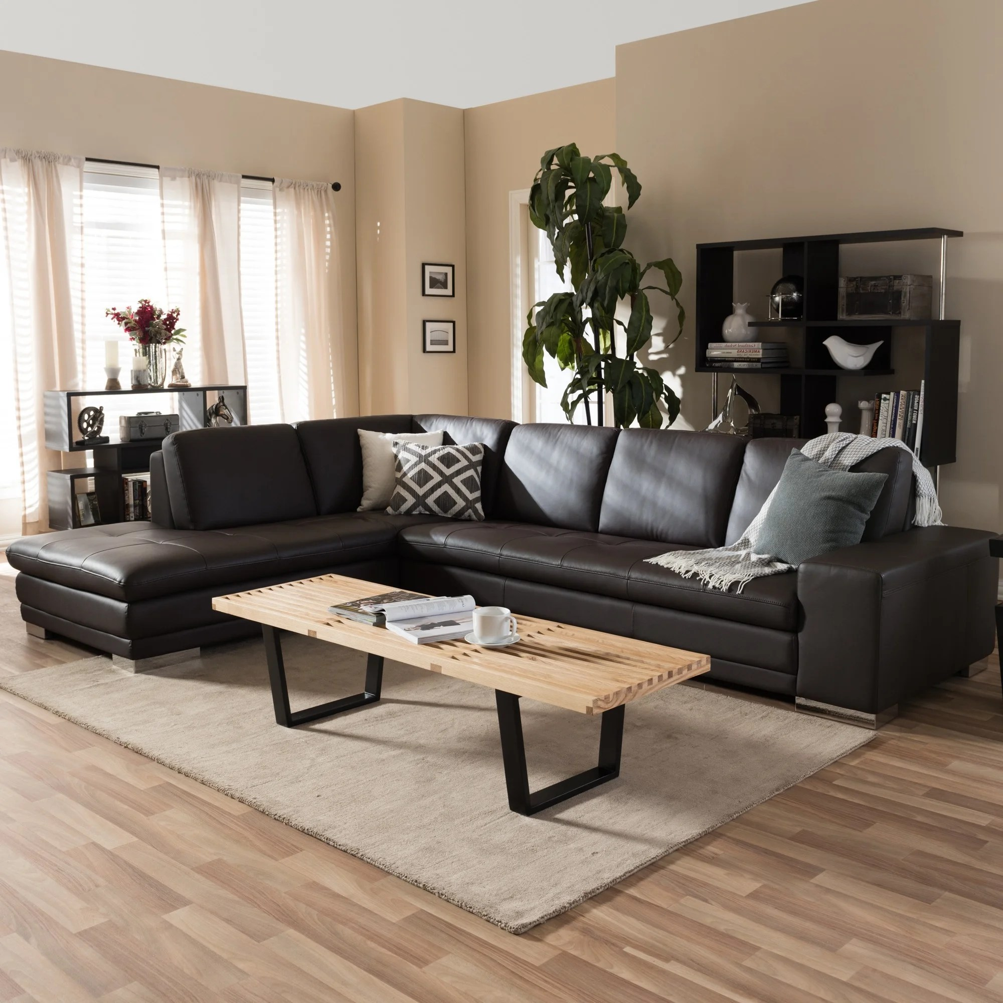 larry dark brown leather reverse sectional sofa chaise set
