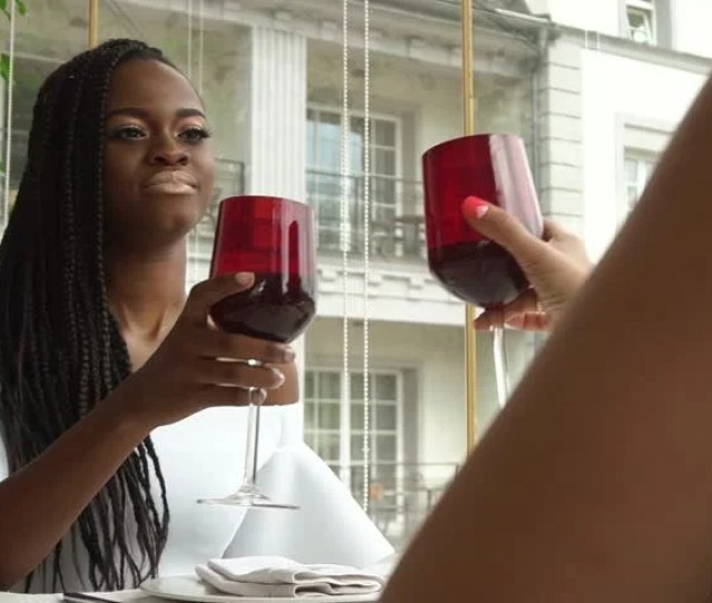 Young Happy African American Woman Drinking Wine In Beautiful White Dress