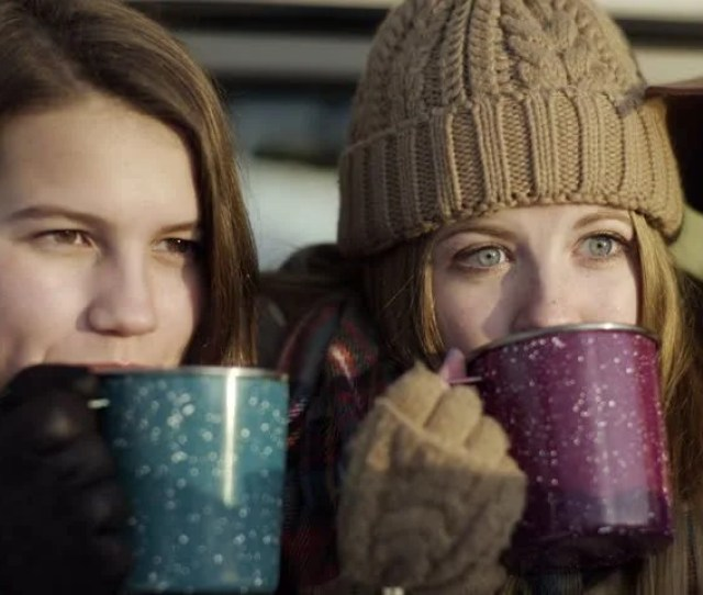 Teens Pose For Cute Winter Selfies Drinking Hot Cocoa Together Then Look At Photos