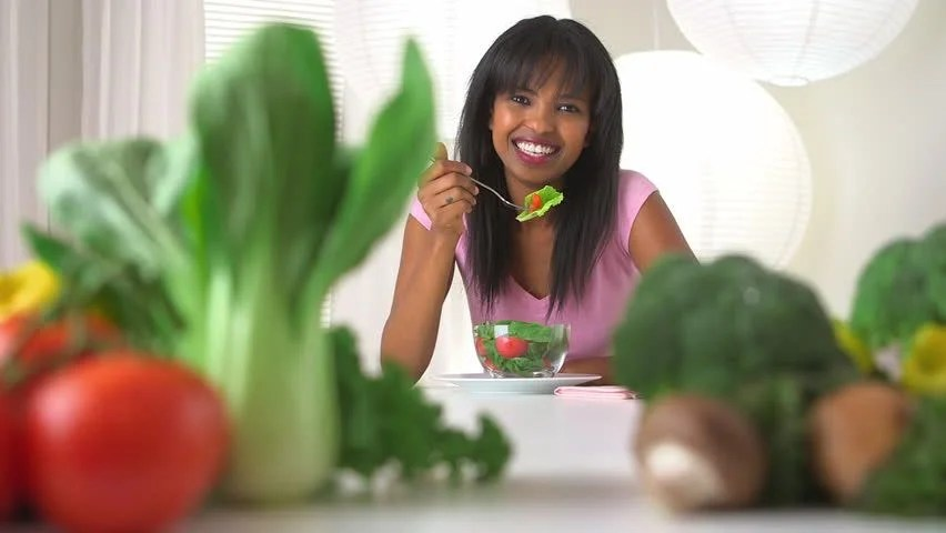 Image result for black woman eating vegetables