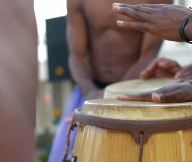 Ebony Afro Americans Plays On Ethnic Bamboo Drums