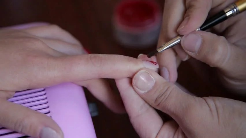 Master Applying Red Nail Polish On Klient Fingers Hd Stock Clip